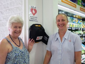 Chris O'Brien in front of the defibrillator at the Dalmeny IGA