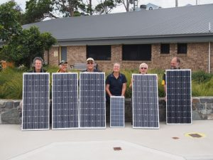 Rotarians with some solar panels