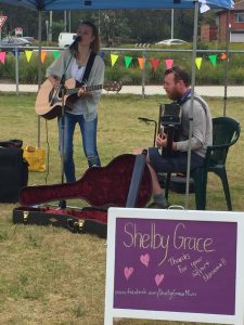 Shelby Grace jamming with Lawrence Macintosh at the markets.